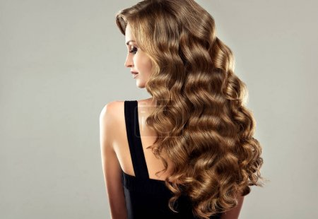 girl with long  and   curly hair