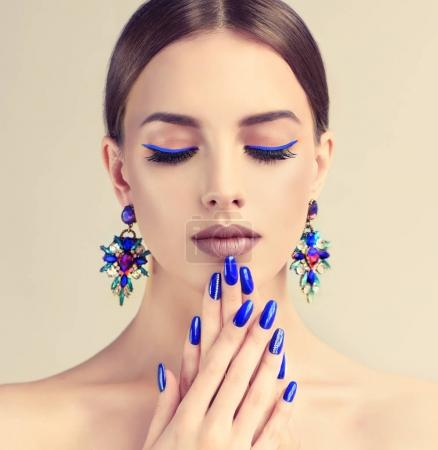 Beautiful woman with fashion make-up and perfect blue manicure
