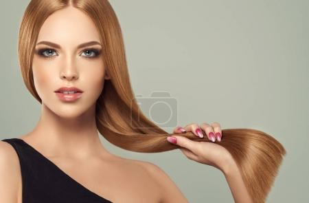 Photo for Beautiful model girl with shiny brown and straight long hair . Keratin straightening . Treatment, care and spa procedures. Smooth hairstyle - Royalty Free Image