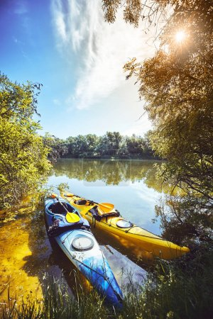 A summer walk along the river on kayaks on a sunny day.