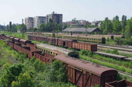 Old cars on railway tracks of Abkhazia