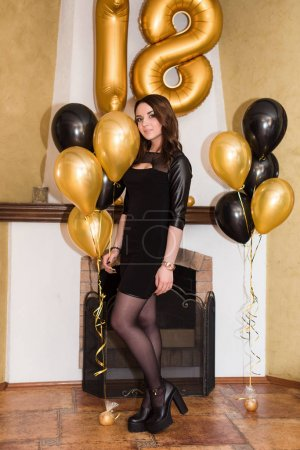Photo for A birthday girl on her 18th birthday with baloons - Royalty Free Image