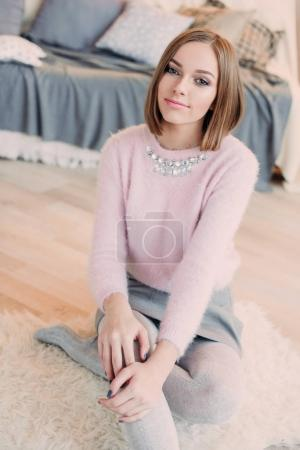 Photo for Soft photo of fresh young woman in pink tender sweater smiling. Pretty girl enjoying early sunny morning at home. - Royalty Free Image