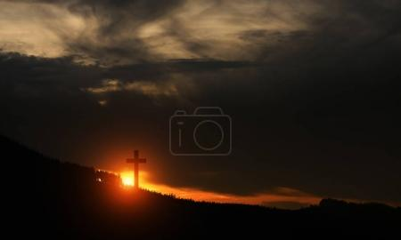 Photo for Sunset over the hill old highlights a large cross - Royalty Free Image