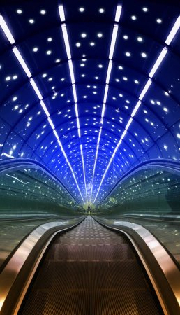 Futuristic escalators lit lamps in blue