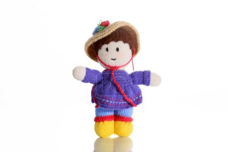 Lady with wool as a toy for child .