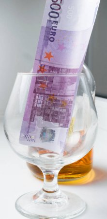 glass of whiskey and euros