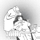 Dentist treats teeth of patient