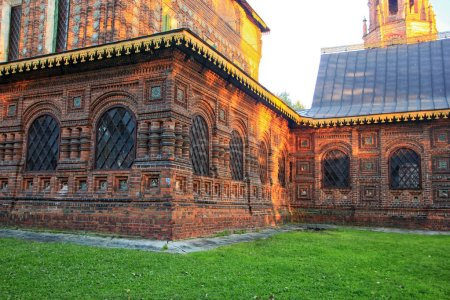 Richly decorated red brick walls of the ancient Orthodox Church