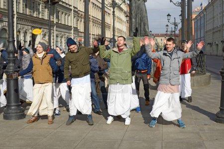 Krishna followers dancing in the street.
