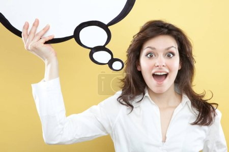 Photo for Pretty young brunette caucasian woman thinking ideas with comic baloon  on yellow background - Royalty Free Image