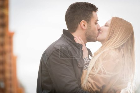 Woman romantic love kiss man in urban city