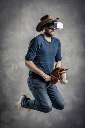 man enjoy Virtual Reality cowboy game