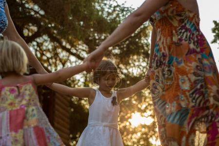 mum with girls doing ring