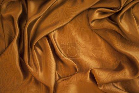 Photo pour Arrière-plan de tissu doré - image libre de droit