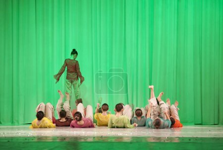 Photo for Dancers on stage, modern choreography a group of dancers from the back - Royalty Free Image