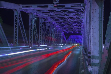 Photo for Colorful close up Trang Tien bridge night view from above in Hue City, Vietnam , light lines from bridge over, natural illumination with green light - Royalty Free Image