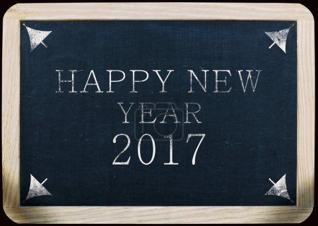 new year 2017 handwritten notice on a slate