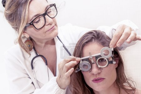 specialist in ophthalmology test new lenses on a patient with ph
