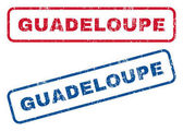 Guadeloupe text rubber seal stamp watermarks Vector style is blue and red ink tag inside rounded rectangular banner Grunge design and unclean texture Blue and red signs