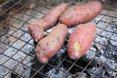 grilled sweet potato on charcoal grill