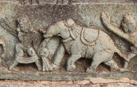 Hampi, Karnataka, India - October 20, 2017: Bas-reliefs in Mahanavami Dibba - The Great Platform UNESCO World heritage site.