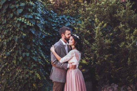 Groom tenderly kissing bride s