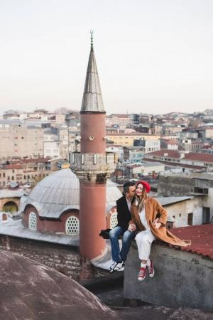 Couple in love sitting  on roof