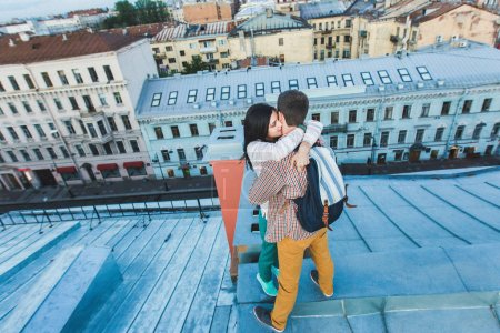Young happy couple hugging on the roof