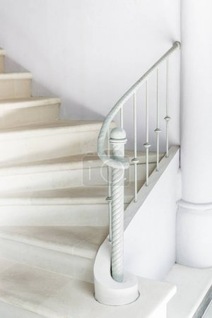 White stairs with vintage white railing.