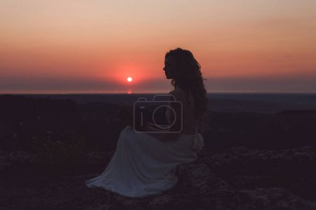 Silhouette of woman at red sunset