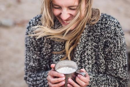 girl drinking cocoa with marshmallows