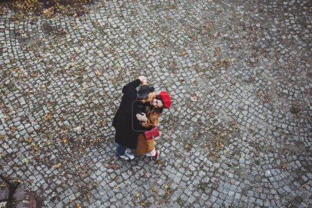 couple embracing in an old european street