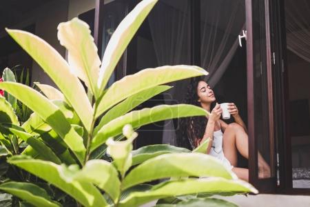 girl drinks morning tea
