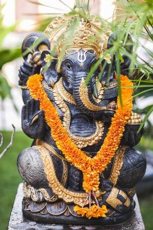 Ganesha in Ubud garden in Bali.