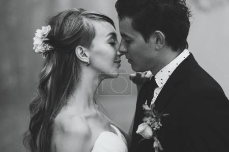 Newlyweds tenderly kissing