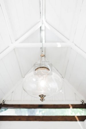 White vintage glass lamp in house