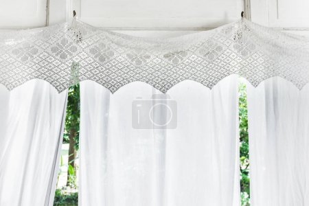 White curtains with patterns