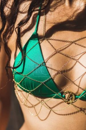 swimsuit on tanned female body