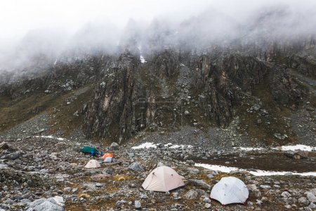 camping with tents in winter mountains