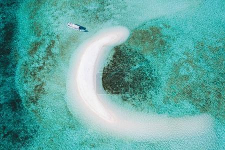 Aerial view of Taka Makassar island in Komodo national park, Indonesia. Empty paradise small white sand island