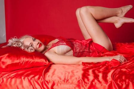 sexy blonde woman in red underwear