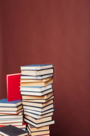 Many stacks of educational books for learning the ...