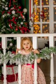Girl in Christmas decorations