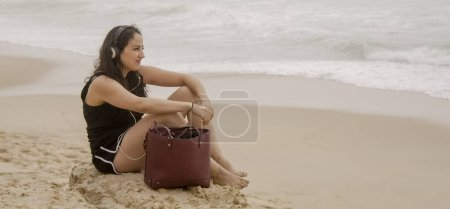 Photo for Beautiful girl has fun on the beach at the oceanfront - summer holiday - travel photography - Royalty Free Image