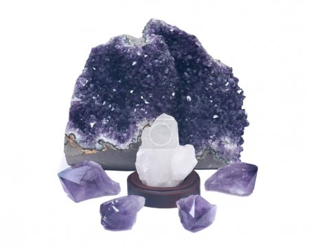 Clear quartz cluster surrounded by amethyst purple...
