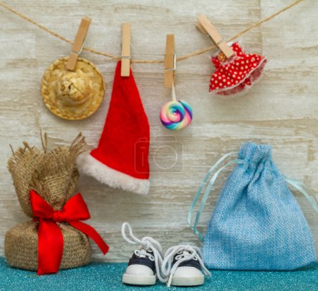 Photo for Santa hat and gift on background, close up - Royalty Free Image