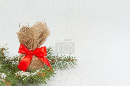 Photo for Gift box with a red bow - Royalty Free Image