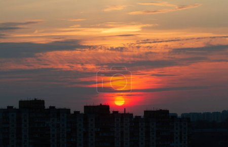 Photo for Beautiful bright sunset over the city. The sun sets over the horizon. - Royalty Free Image