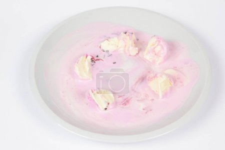Ice cream in a white plate for a child